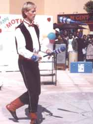 Donovan the juggler juggles with clubs