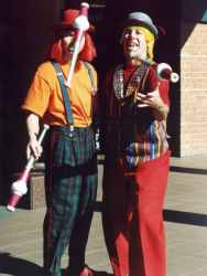 Gerard and Pinky the clowns juggling with clubs